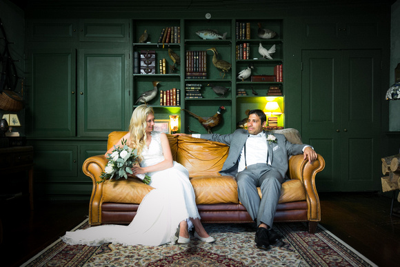 Bride and groom on couch in green room