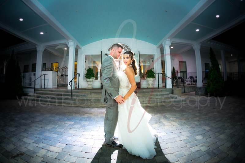 Wedding couple backlit in front of a hotel