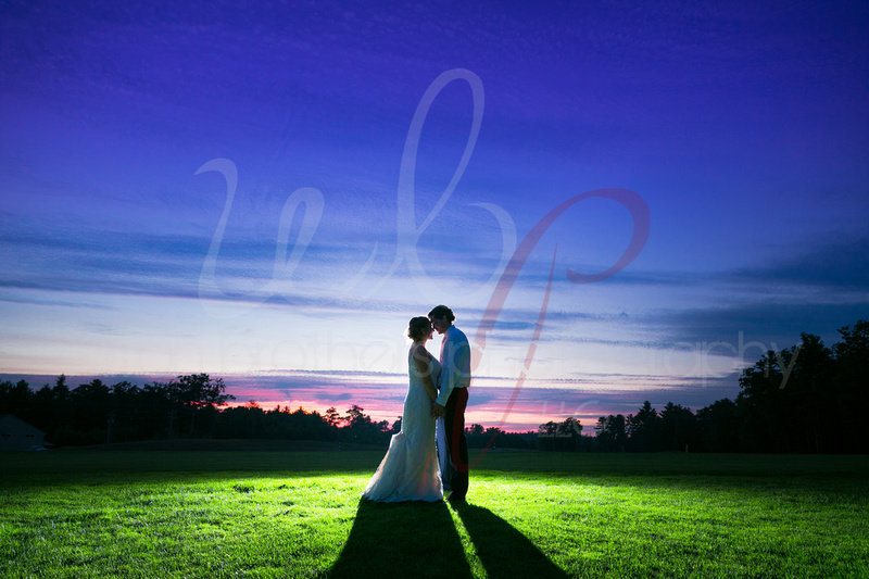 silhouetted couple at sunset on a gold course