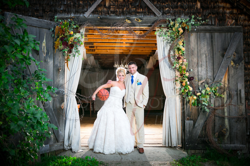 Newly wed couple in front of barn