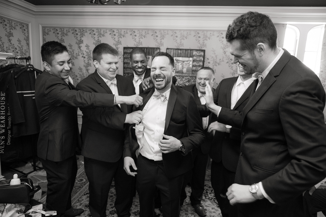 black and white guys getting ready for wedding