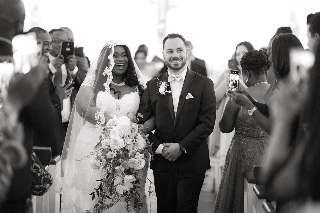 Black and white groom and bride recessional