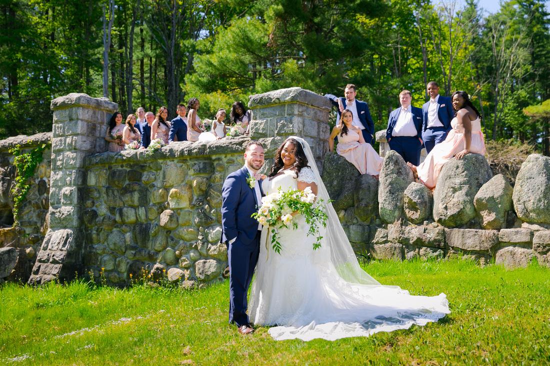 Bridal party behind couple on bridge