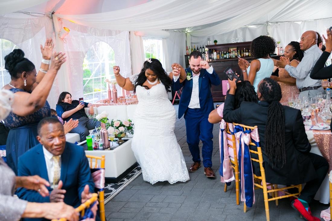 Bride and groom introduced into reception