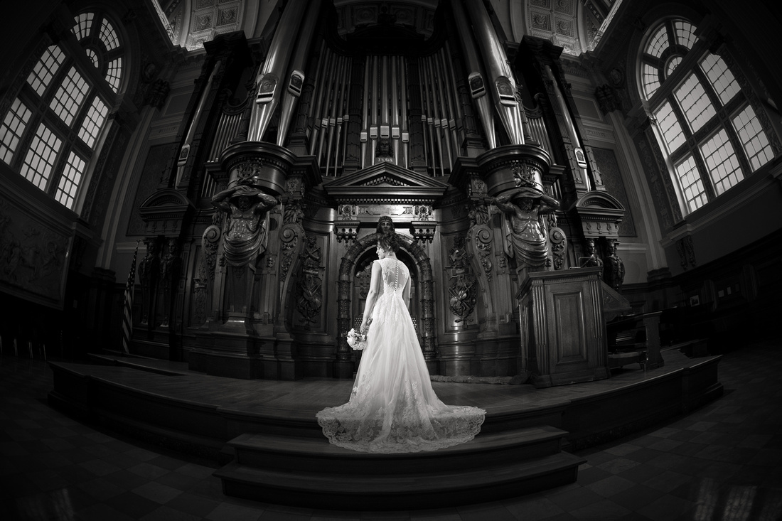 Bride poses in music hall