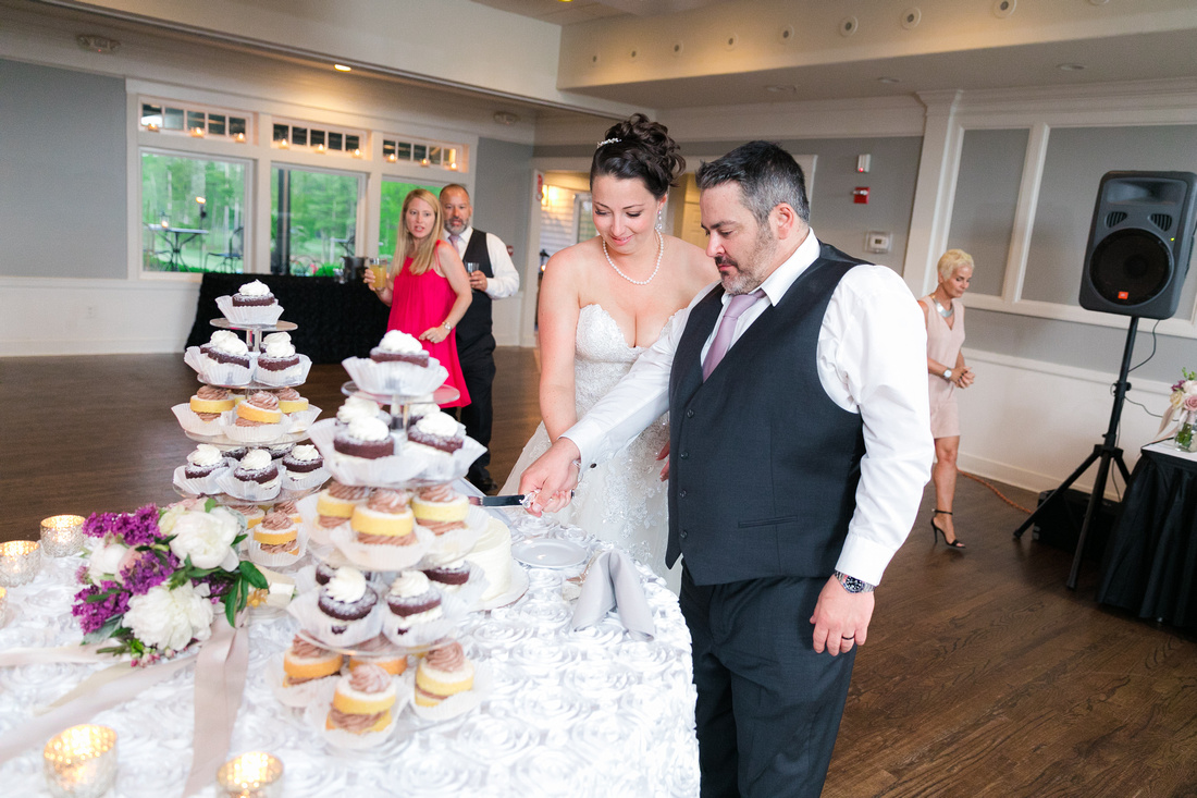 bride and groom cut their wedding cake