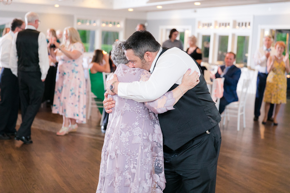 Groom and his mother embrace