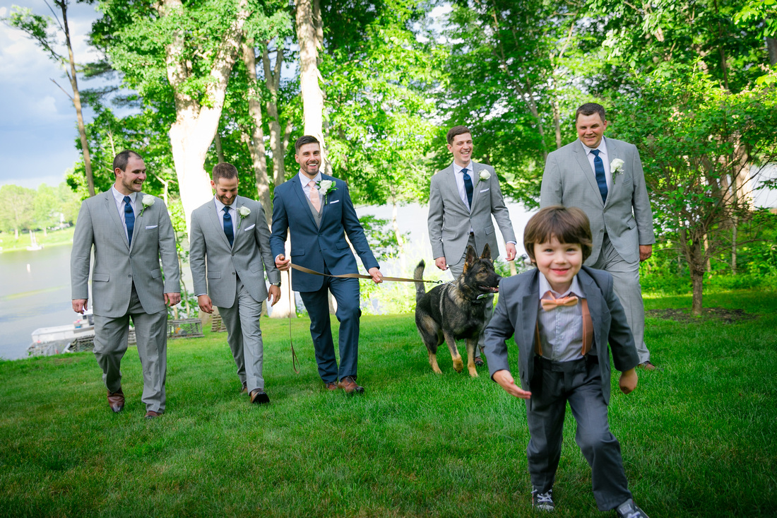 Groomsmen walk with the dog
