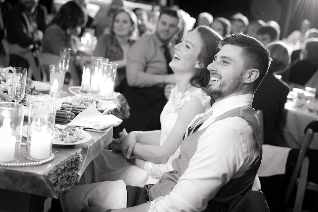 Bride and groom react to a toast