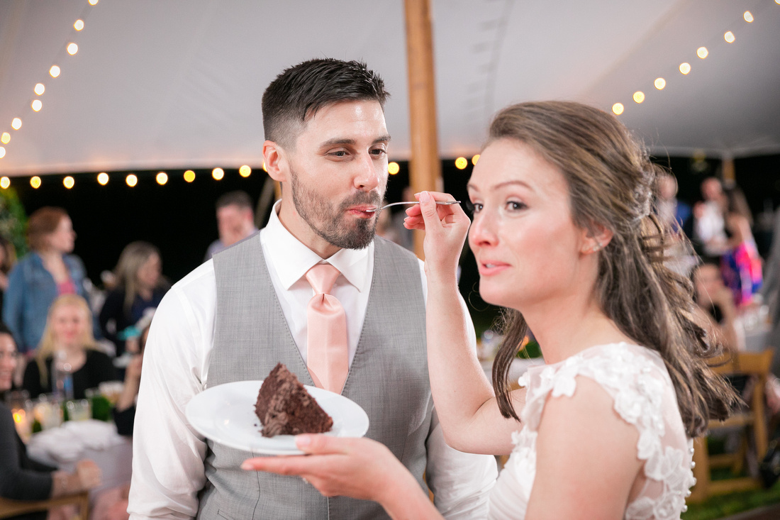 Bride feeds cake to the groom