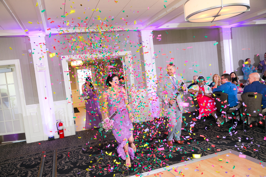 bridal party enter reception with confetti