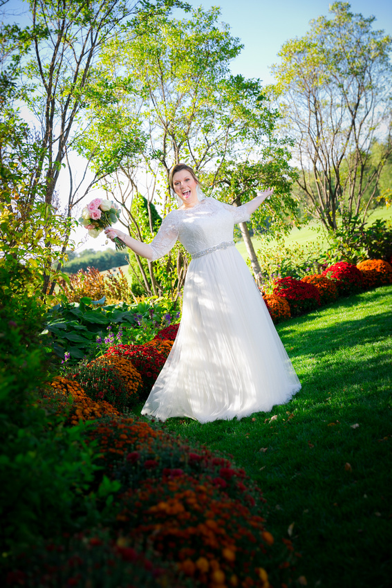 Funny bride around colored flowers