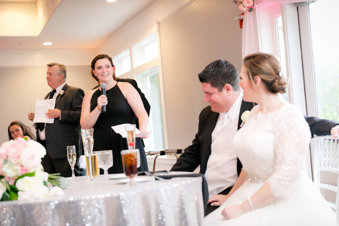 Girl toasts to the bride and groom