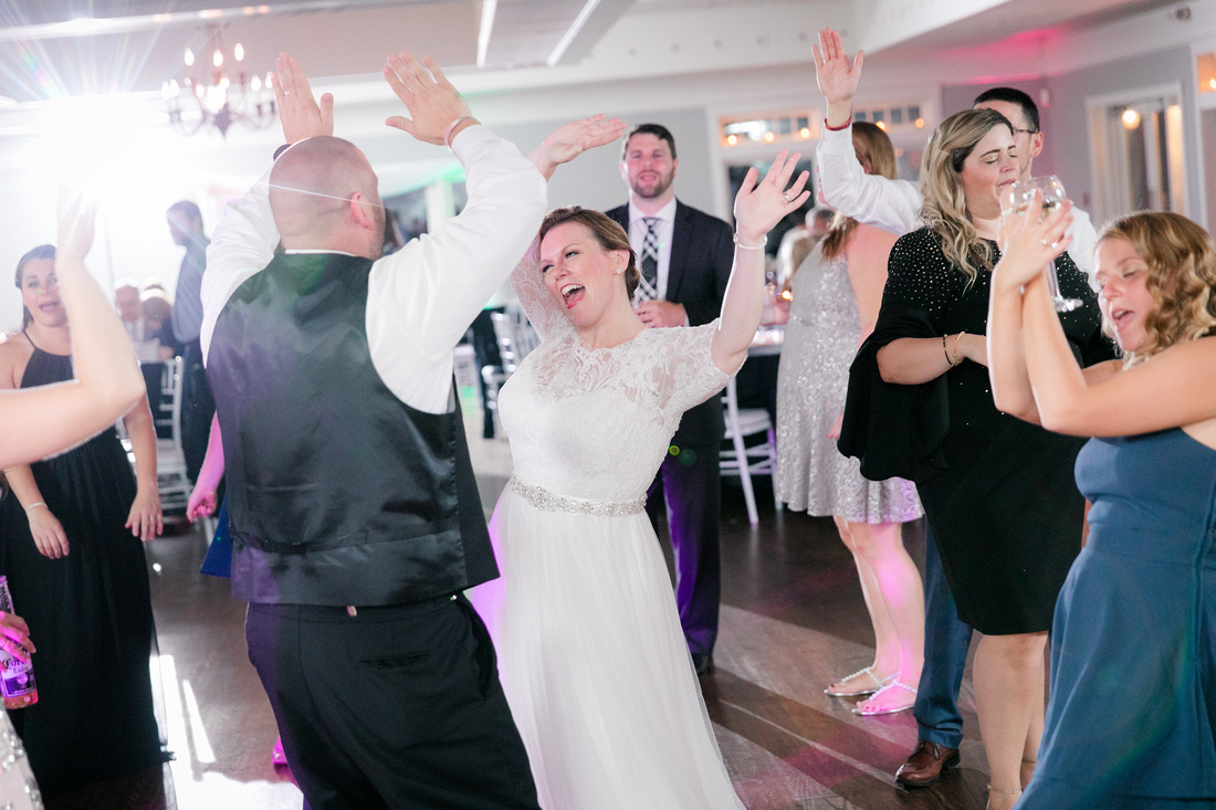 Bride dances with guests