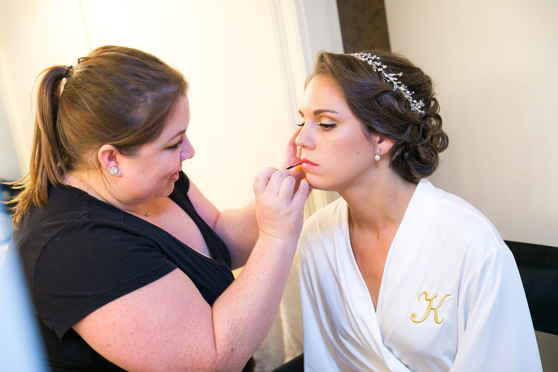 makeup being put on bride