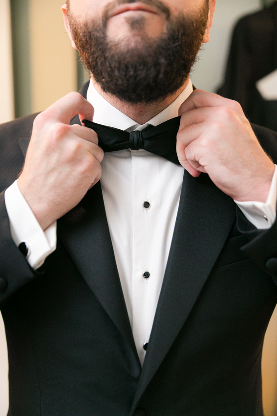 Groom fixes bowtie