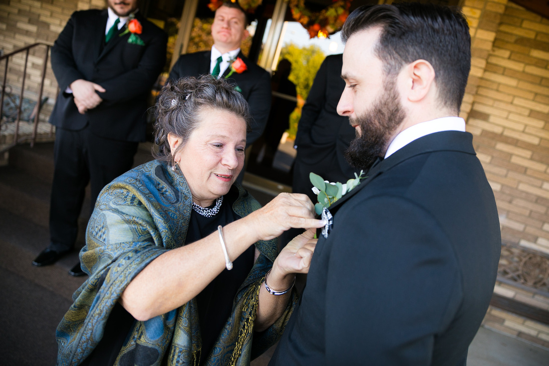 Mom pins boutonniere
