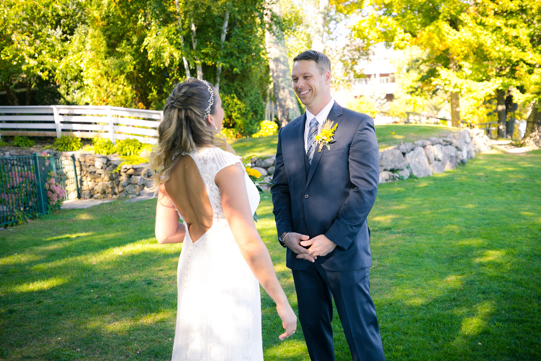 Groom sees bride at Church Landing in Meredith, NH