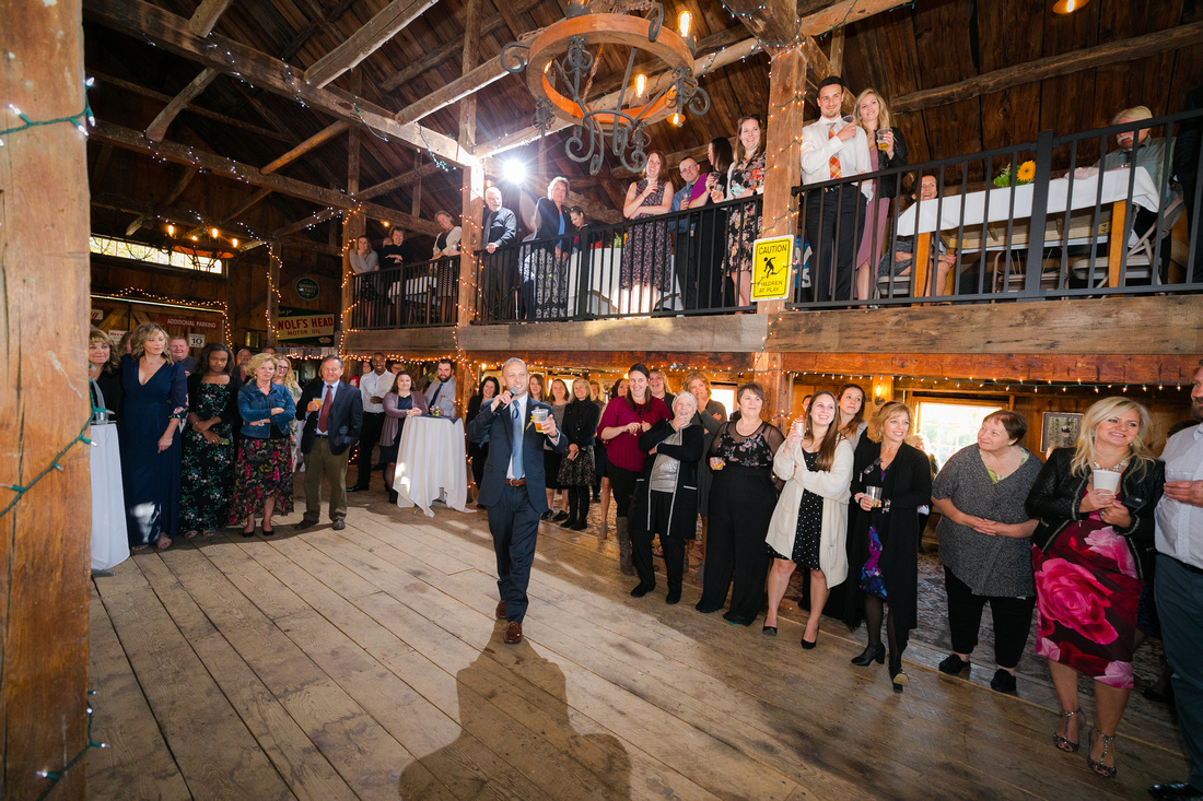 Best man gives speech in barn