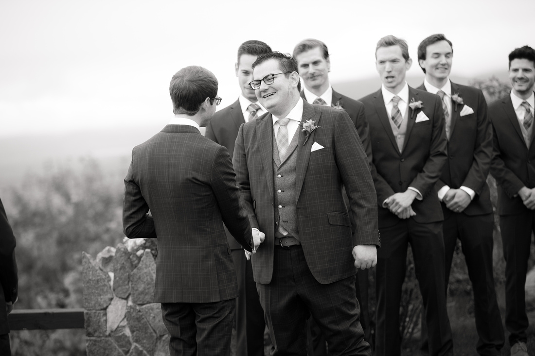 Groom smiles at his partner