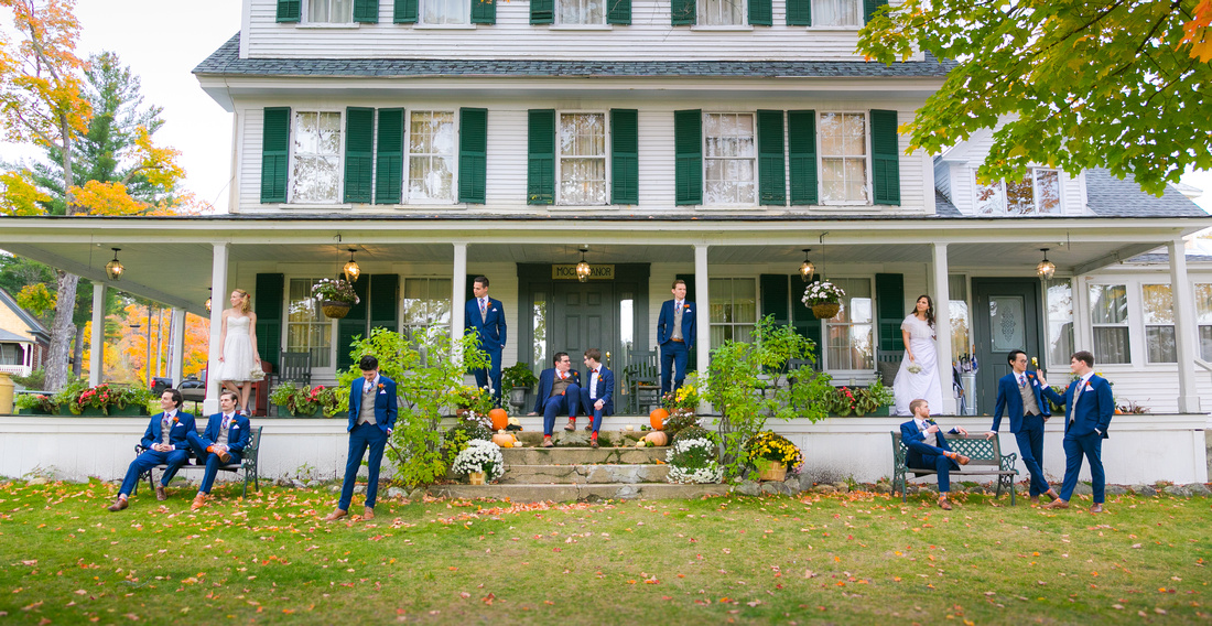 Bridal party pose in front of house