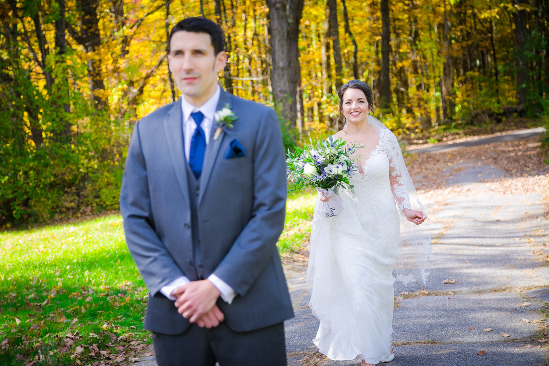 Bride walks up behind groom