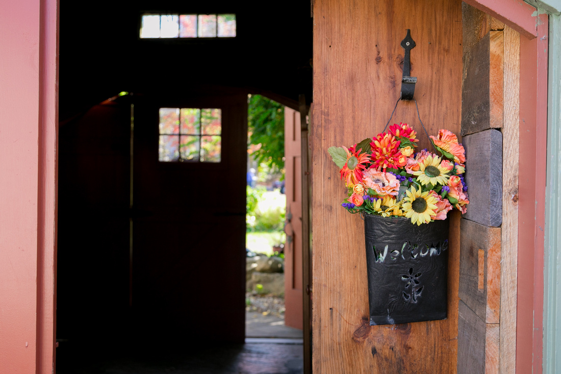 Flowers on barn door at Mile Away Restaurant Milford