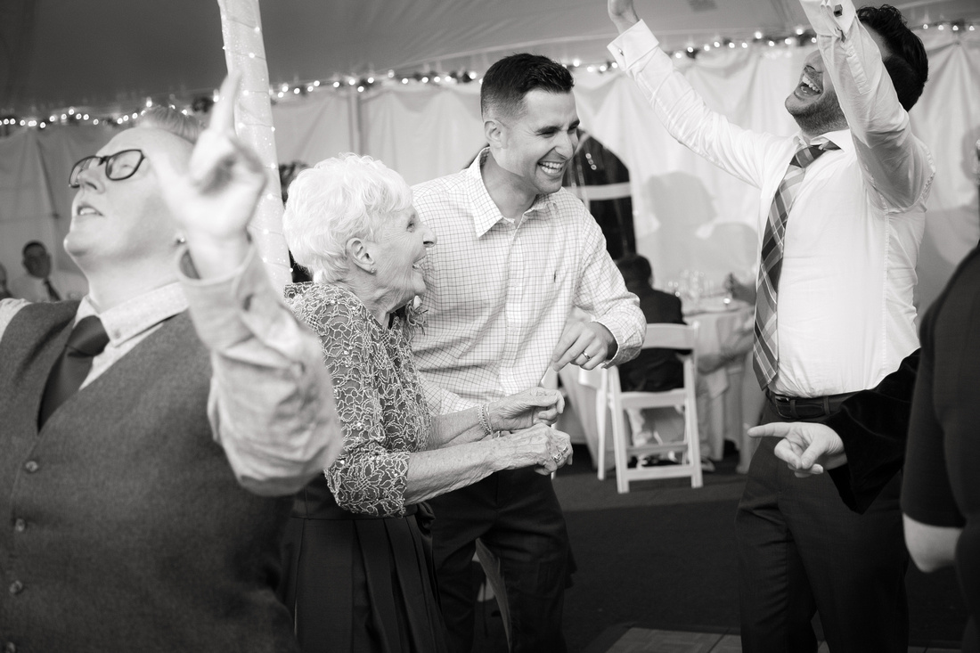 People dance at wedding reception