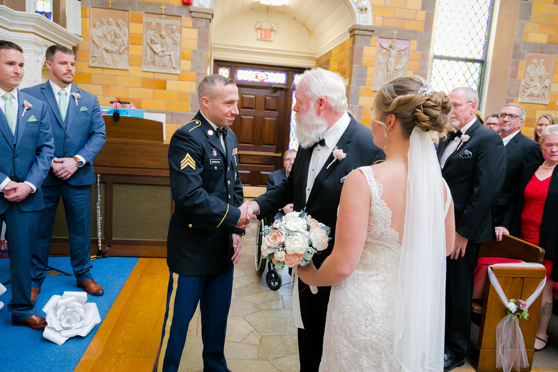 Father of the bride shakes groom's hand