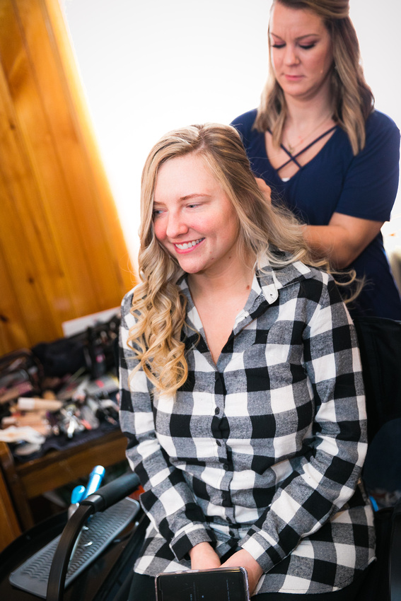 Bride gets hair worked on