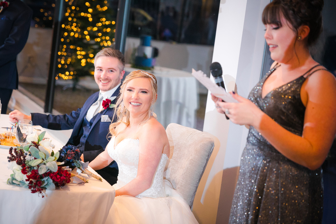 Maid of honor toasts the bride and groom