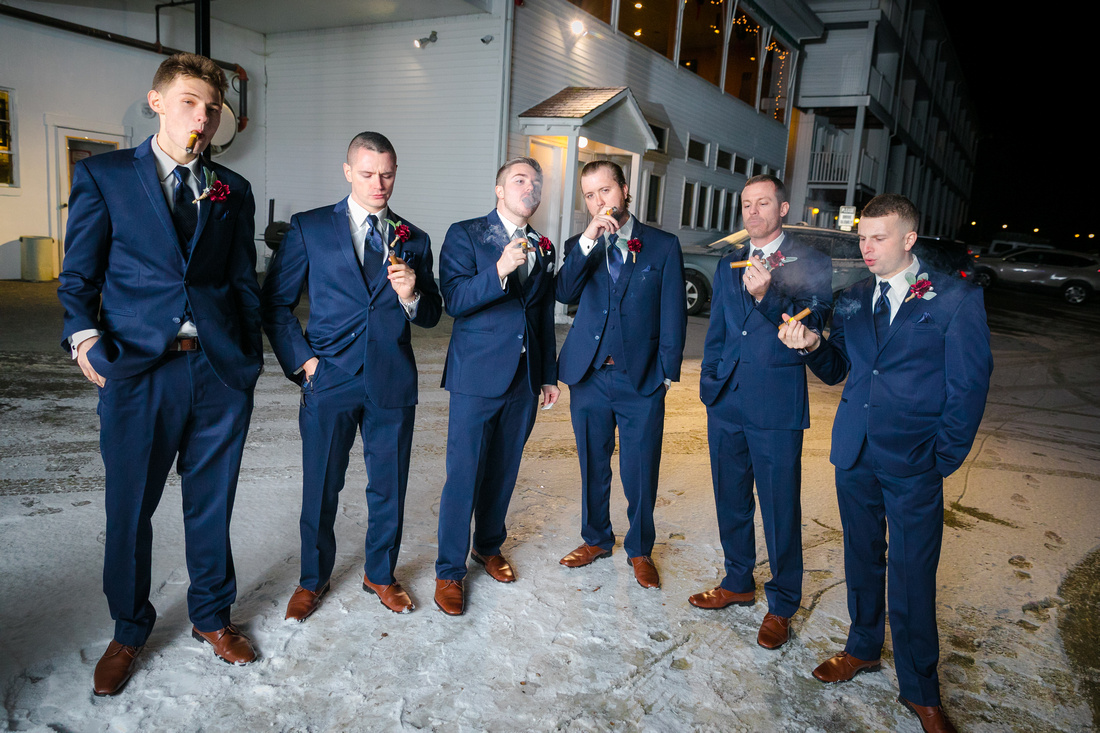 Groomsmen smoke cigars
