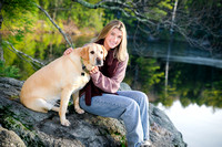 girl sits with golden labrador