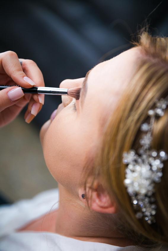 bride gets makeup put on