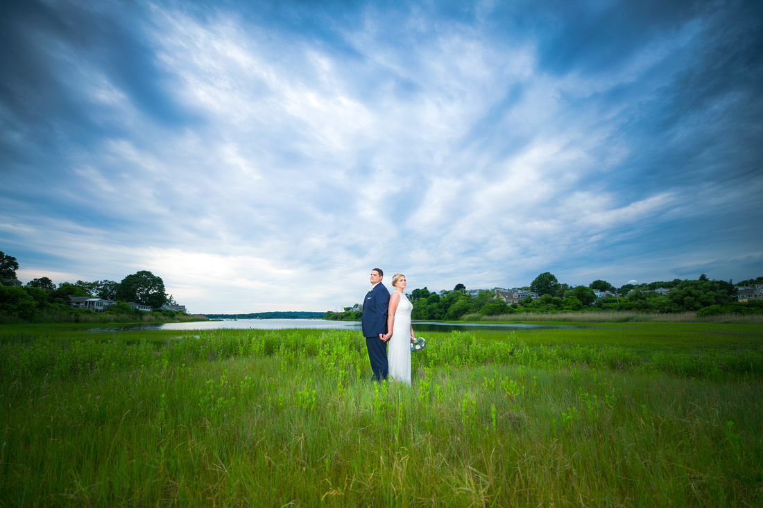 Bride and groom on grassy field