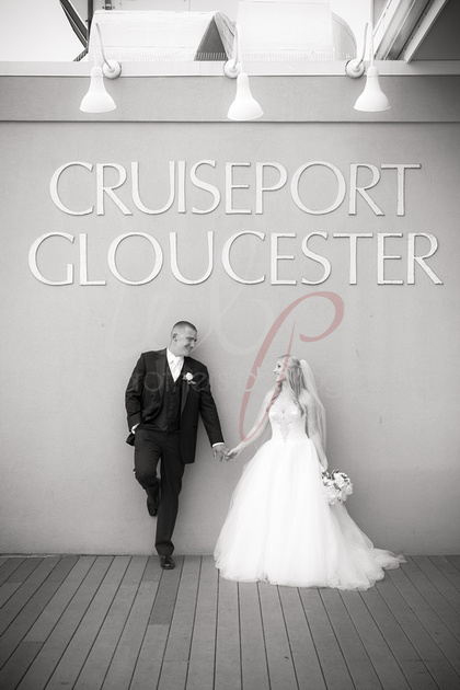 Married couple under cruiseport gloucester sign