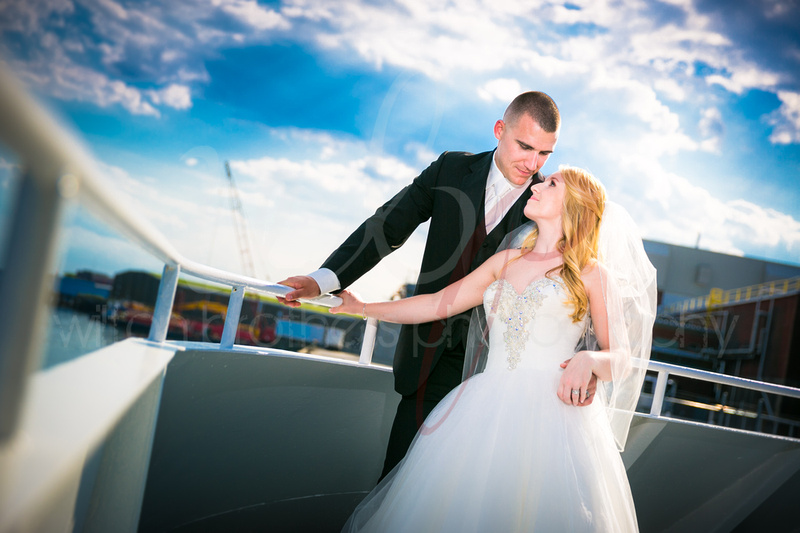 Married couple on bow of boat