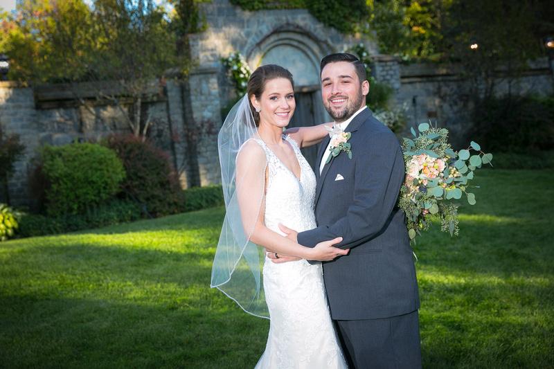 Married couple smiling at Hidden Hills Resort