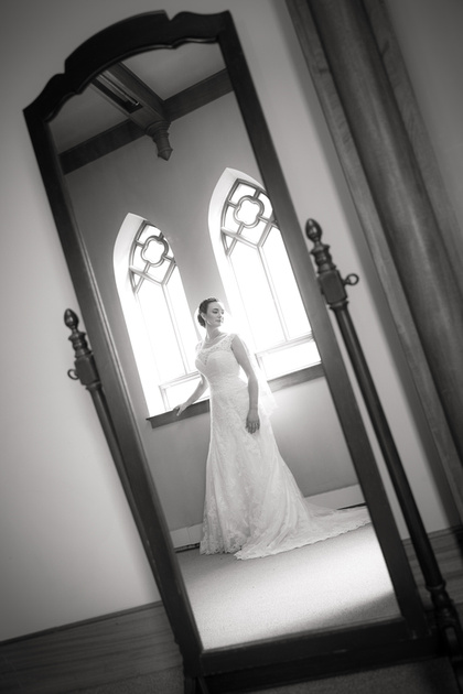 Black and white bride reflected in mirror