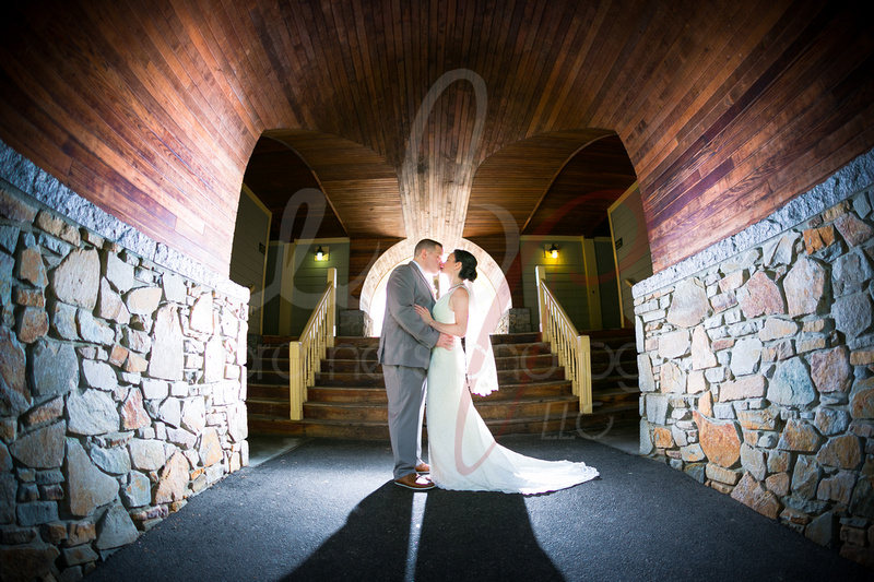 Wedding couple embracing in a tunnel